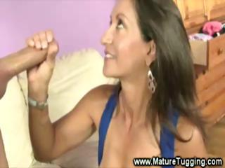Sexy Milf Tugs Cock And Flashes Her Bits