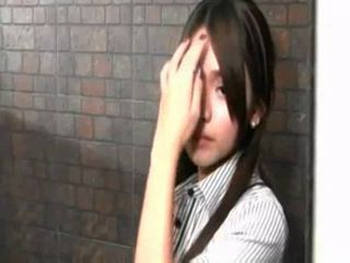 Sexy Asian ladyboy Amor smokes for you in the bathroom.