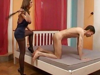 Classy bitch in perfidious pantyhose whips her male slave