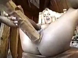She uses brutally big dildo for pleasure