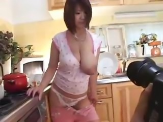 Asian with huge tits is showing them off in different poses