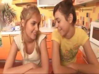 While having  a meal two yummy lesbian bimbos decide to get naked