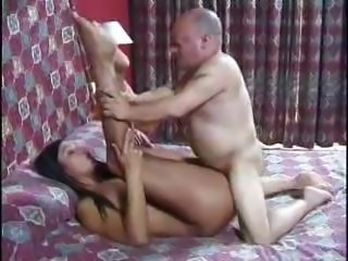 Long-haired brunette chick with a pair of big breasts gets fucked by an age-old beggar