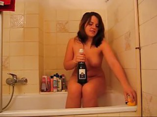 Curvy cutie sits on champagne keep concerning check concerning bathtub