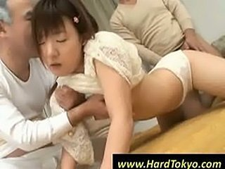 Japanese babe gets fucked in a groupsex