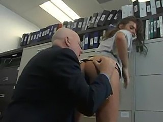 Big beautiful ass gets fucked hard by two. Office.