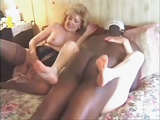 Busty granny and her friend have fun with a black guy - snake