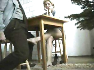 Blonde college cutie taking a test gives the proctor a footjob