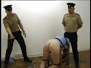 Naughty blonde prisoner gets cuffed to a preside and whipped hard by the guards