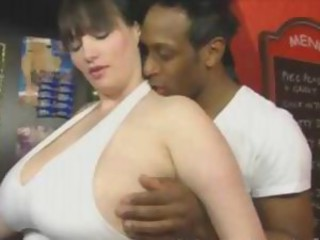 Simone is a chubby brunette with beefy melons who does Omar's prick