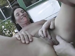 Mature momma gets some action from a gent outdoors near the tub