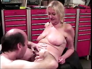 Chubby blonde granny Anastasia Sands fucks the mechanic in the garage