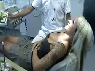 Busty tattooed blonde rinses her mouth out with the dentists man juice