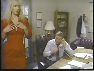 Classic blonde babe Melanie Moore services the boss on the desk