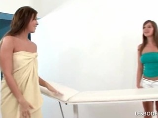 Busty Lesbian Hottie Cate Is Giving Natali A Sensual Massage
