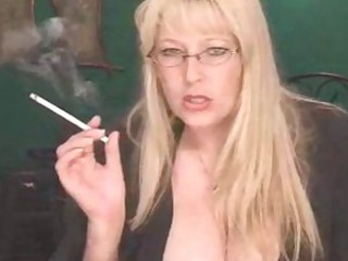Off colour Mature Blonde Smoking Solo