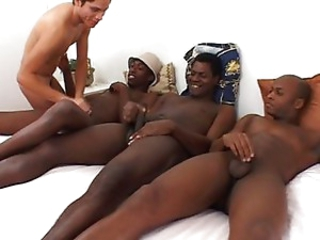 Four homosexual guys in bed