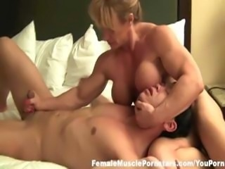 Buff muscle bound blonde sits on his face and jerks his dick