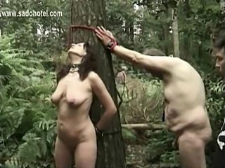 Slave tied to a tree with got pulled on her nipples and got heavy weight on...