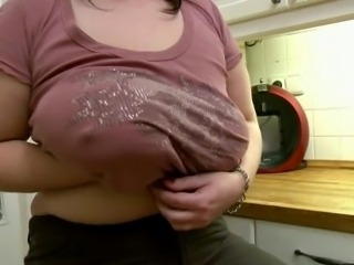 chubby mom shows her body near kitchen