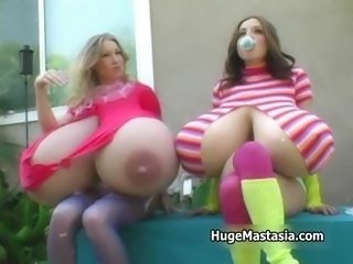 Two hot babes showing of their giant big part4