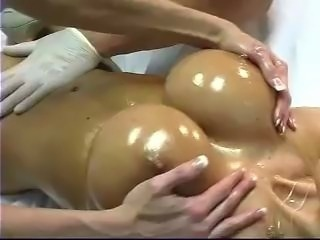 Ashley Lawrence gets rubbed down together with her pussy rubbed by a female together with her...