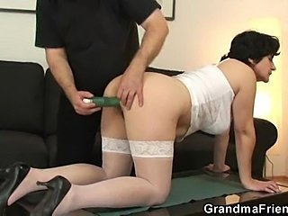 Horny granny blowing two guys at once