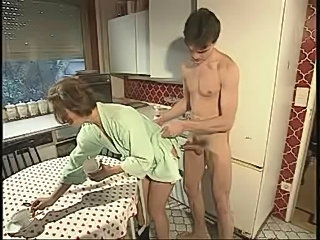 Young son fucks his own mom in the kitchen