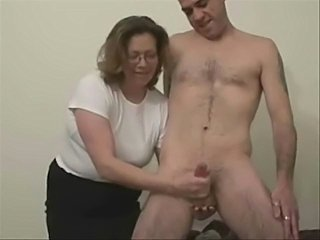 Mature wife jerking my cock