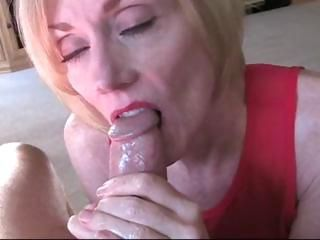 Mature blonde shows guy how to jack off before she sucks on his cock