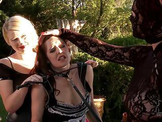 Sexy Maid Samantha Bentley Gets Punished By Blonde Tegan Jane And Kinky Masked Woman Paige In The Open Air. They Punish A Lady In The Backyard.
