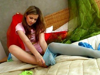 Lovely teen blonde tries on her new pantyhose