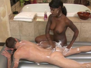 Ebony masseuse massaging client...