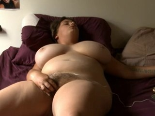 Amazing busty BBW masturbates on bed