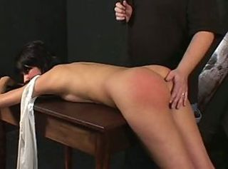 Hot brunette spanked hard by will not hear of master
