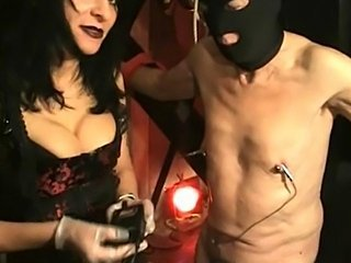 Dirty slave gets large meat hooks through is nipples and gets spanked by...