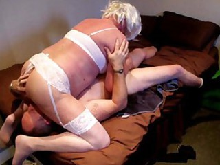 Granny in a white wig gives blowjob to..