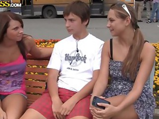 Two adorable chicks pleasing a guy in..