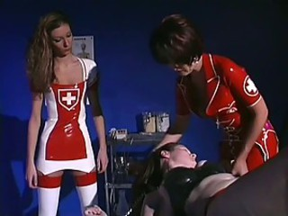 Latex Nurses Tie Down Girl For Punishing