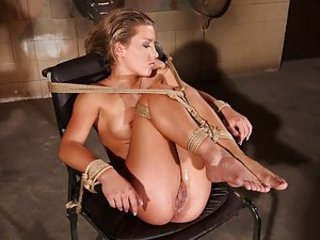 Kathia Nobili this time captured Bianca Arden and kept her in a special wheelchair with Bianca bound to it. The chair has a hole right where the sitter's pussy is located and Bianca will be the first one to experience Kathia' experiments on her new toy. B