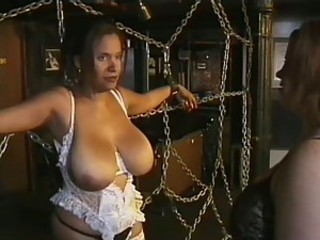 Three Super Busty MILFs Have Fun In a Bondage Sex Dungeon