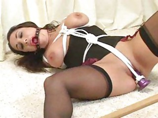 Bound coupled with gagged with spreader bar