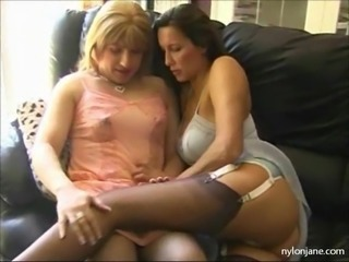 Nylon Jane puts her feet and tongue all over a horny TGirls hard cock.