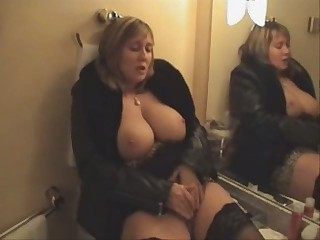 Busty grown up masturbates