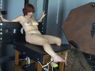 Young cheerleader brunette loves to tie up her mistress and suck her feet