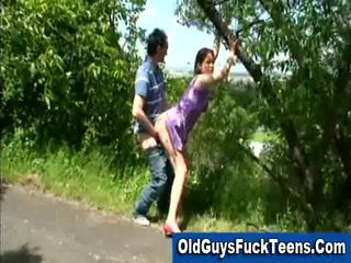 Older man fucks young brunette outdoors