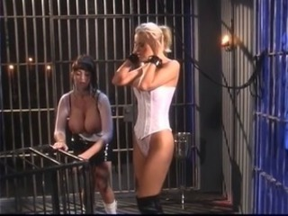 Dominatrix punishes kinky blond in jail cell