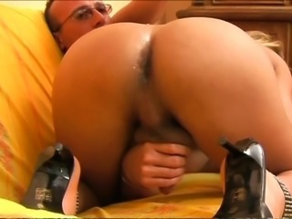 Big titty blonde Tgirl sucks and strokes a cock.