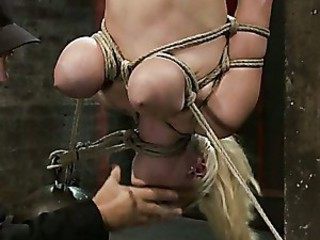 Young teen blonde has her tits tied..