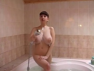 Busty girl in bath